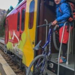 getting on a train with bike