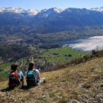 Hikers admiring the view on lake Bohinj