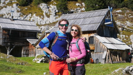 happy hikers on an alpine meadow