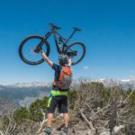Mountain biker in the mountains above the valley
