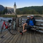 cyclist in Bohinj valley by the church of st. John the Baptiste