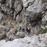climbers in the triglav north wall