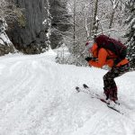 backcountry skier descending to bohinj valley
