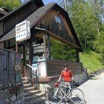 gravel cyclist by a mountain hut