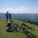 mountain bikers on top of the hill